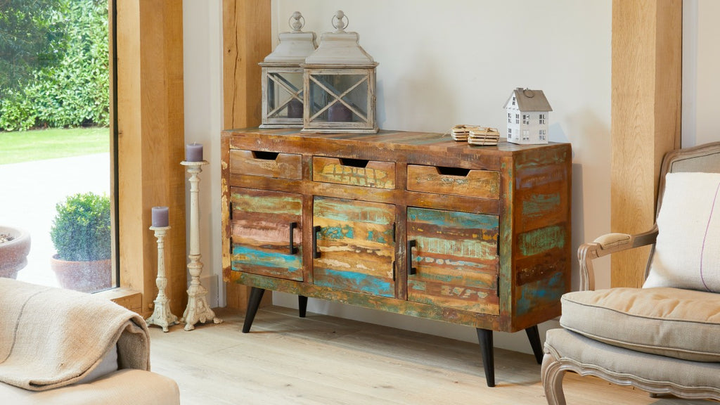 Colourful reclaimed wood sideboard in living room setting