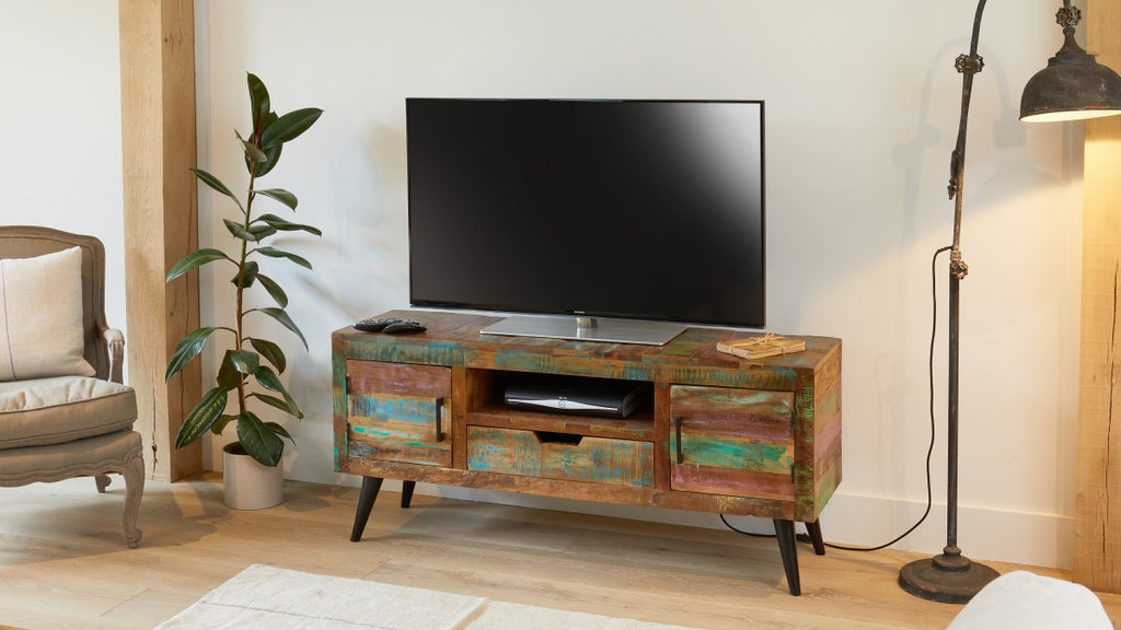 TV cabinet made from colourful reclaimed wood, situated in modern living room.