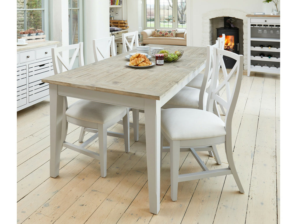 Farmhouse style dining set in dining area with wooden floors