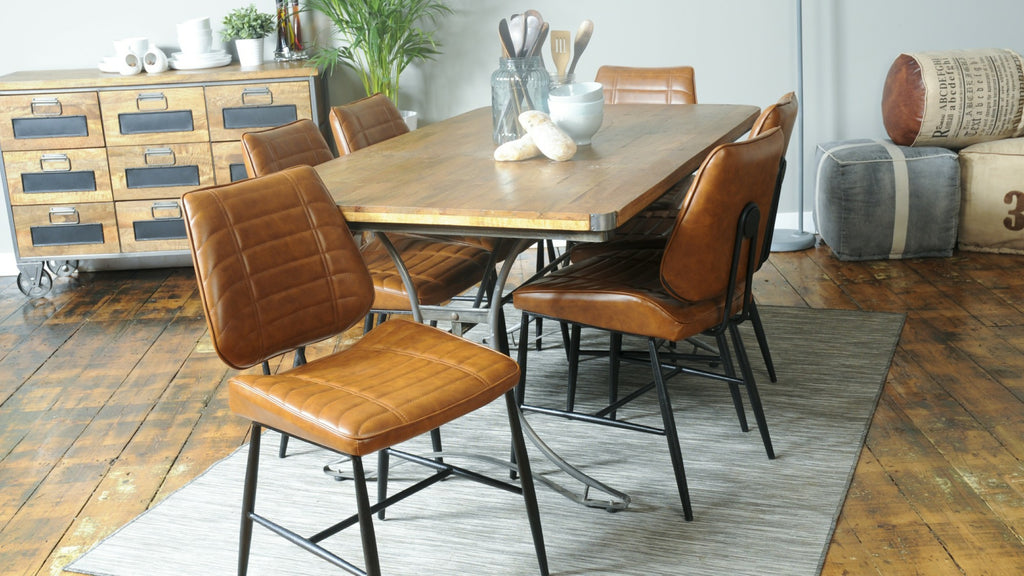Industrial dining table and chairs in living room setting