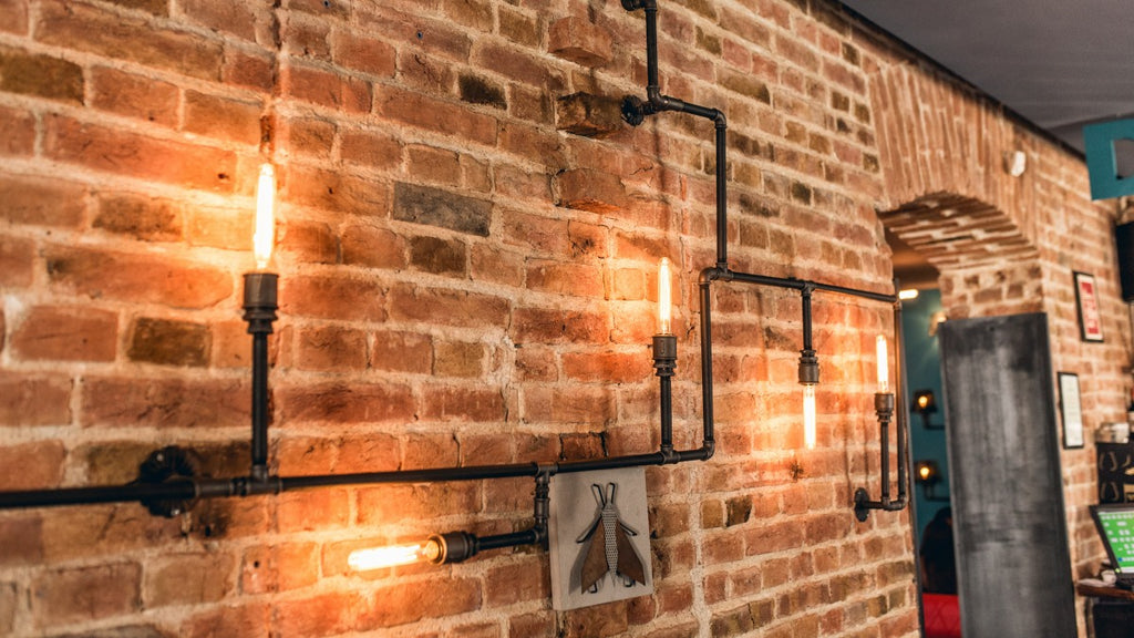 Industrial style lighting on exposed brick wall