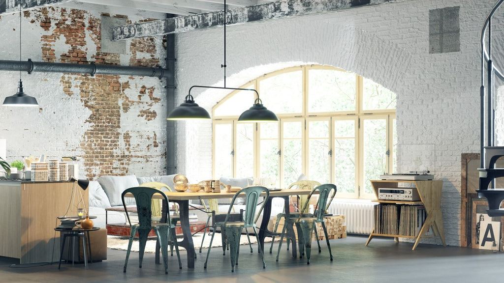 Industrial style dining area with white brick wall