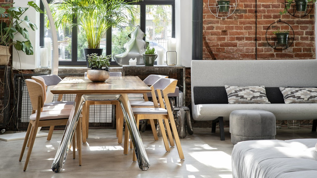 Industrial dining table and adjacent sofa