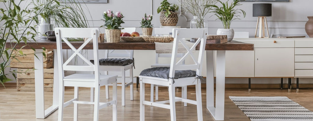 Rustic dining area with table and chairs