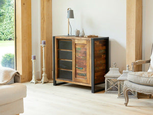 Small reclaimed wood storage cabinet with four drawers and sliding door