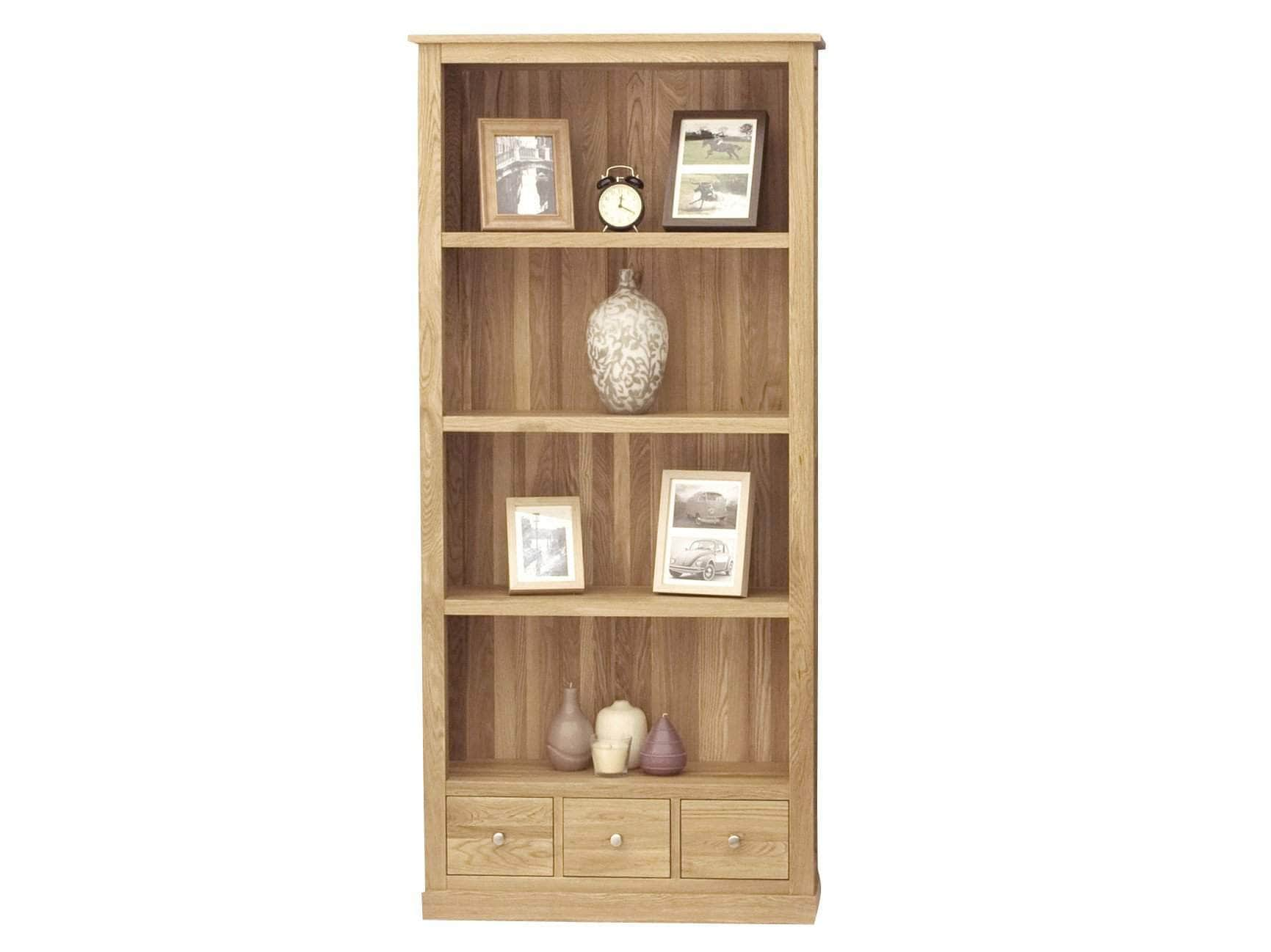 Large solid oak bookcase with four shelves and three small drawers at the base