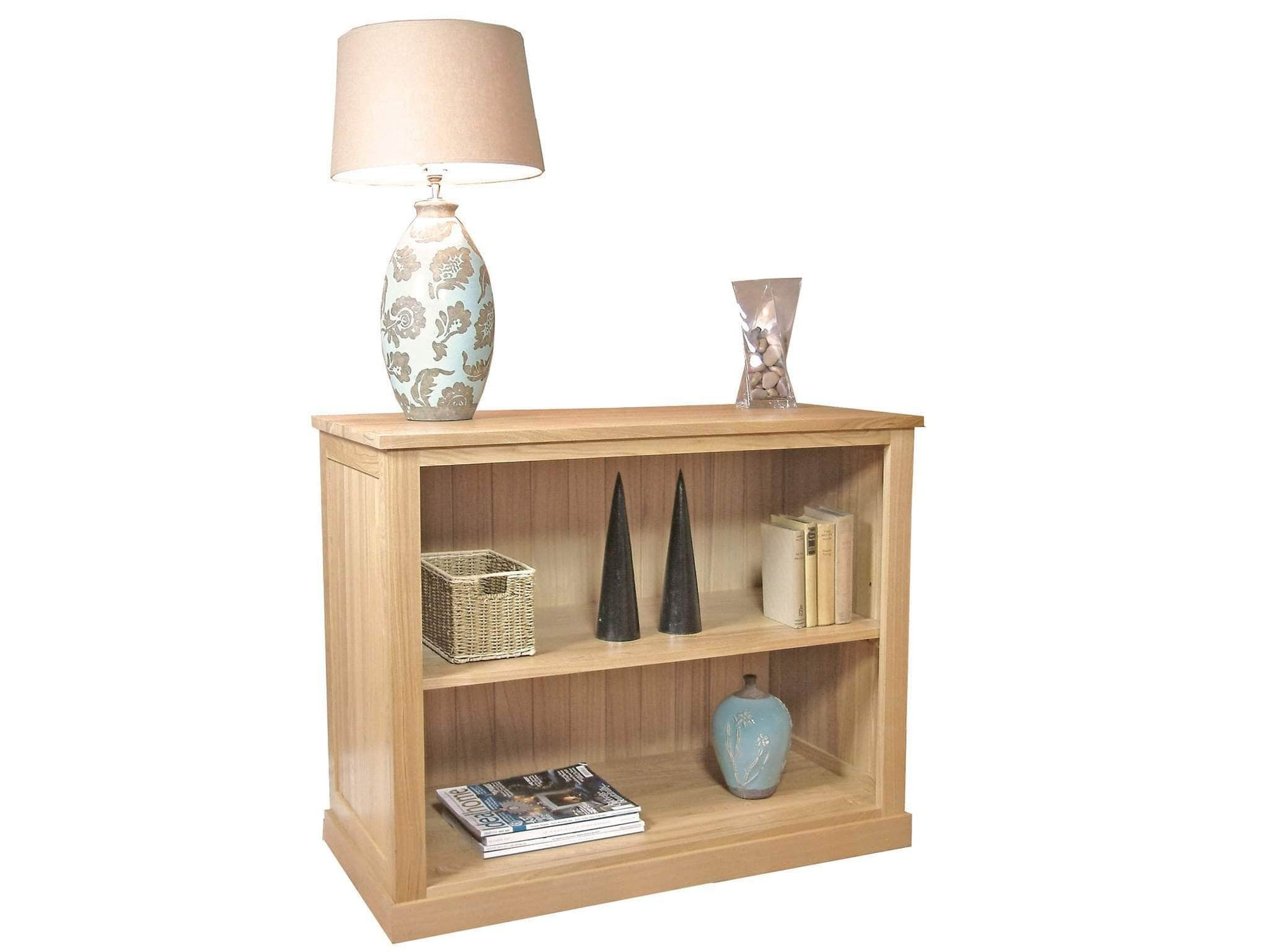 Small, low height bookcase made from solid oak, with one middle shelf