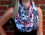 Black and White Crest Scarf with Pink PomPoms