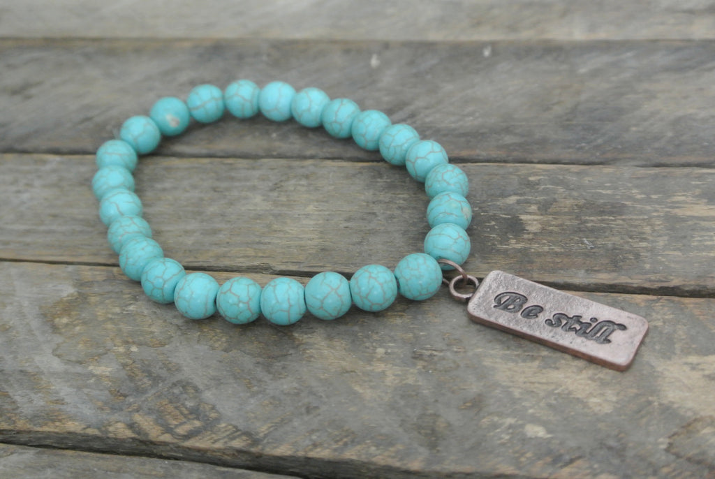Turquoise beaded bracelet with Copper toned Be Still Charm