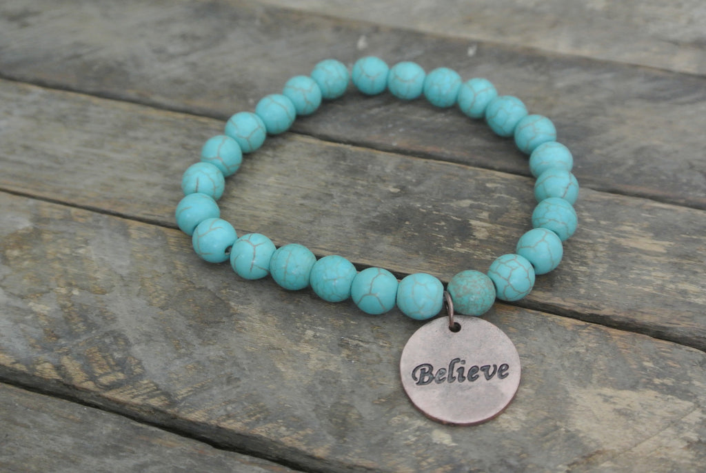 Turquoise beaded bracelet with Copper toned Believe Charm