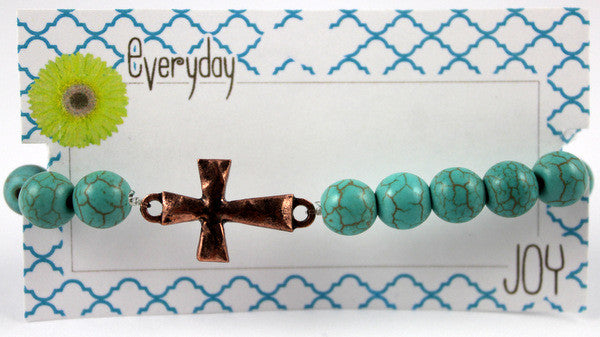 Turquoise beaded bracelet with Copper toned Hammered Cross Charm
