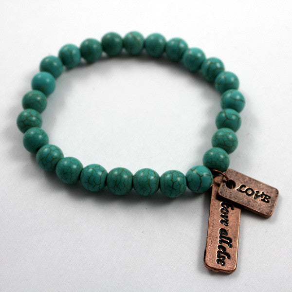 Turquoise beaded bracelet with Copper toned Love Above All Else Charm