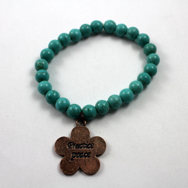 Turquoise beaded bracelet with Copper toned Practice Peace Charm