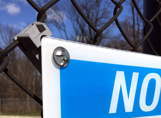 Close-up of Sign Guardian chain link fence mount