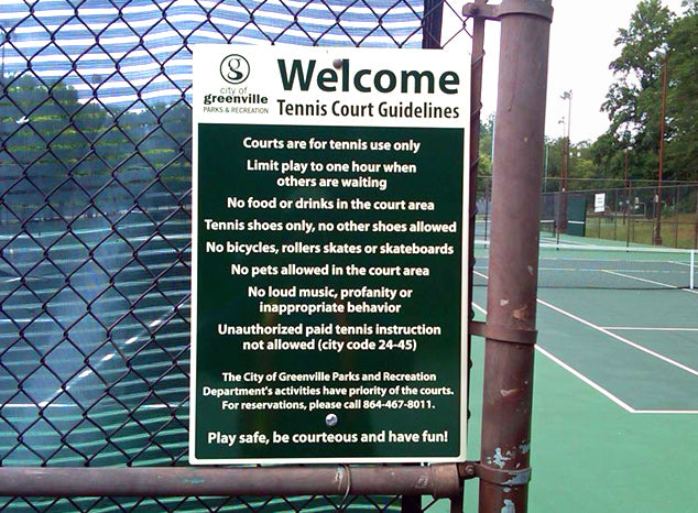 Guidelines sign hung outside tennis court.