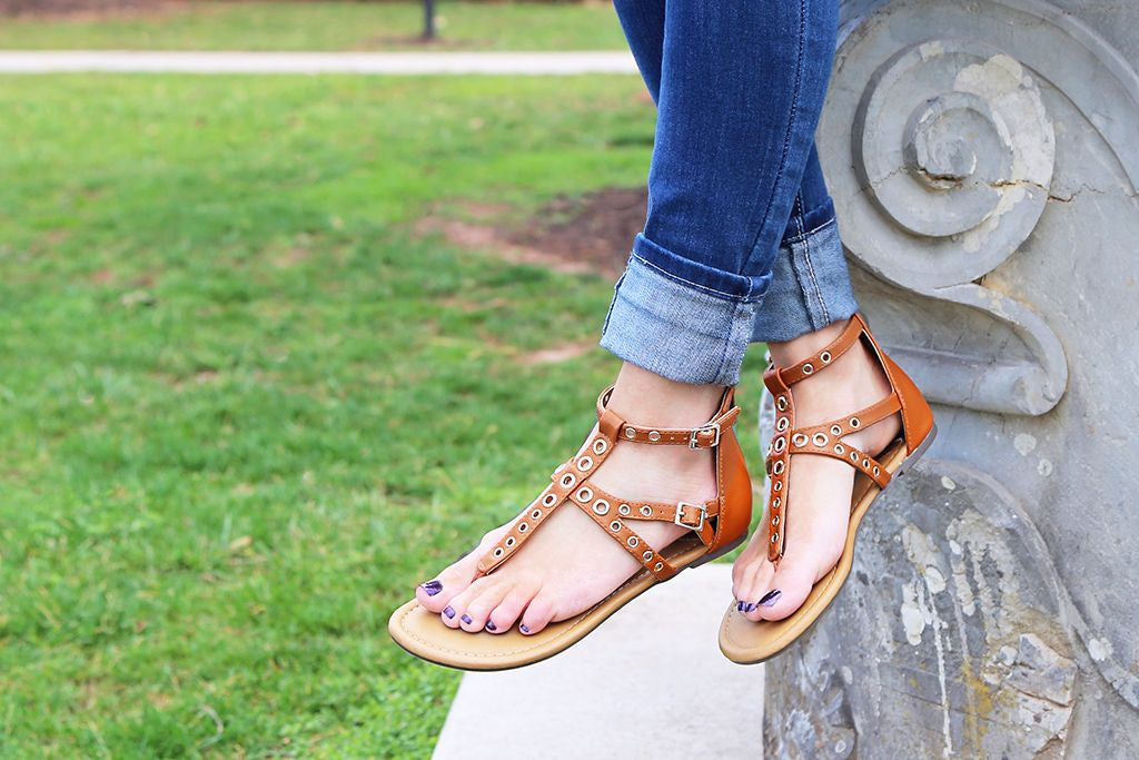 Style your spring break look with strappy thong sandals from Madeline Shoes.