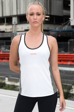 Female runner wearing an ECODRY® Run Racerback from Kusaga Athletic