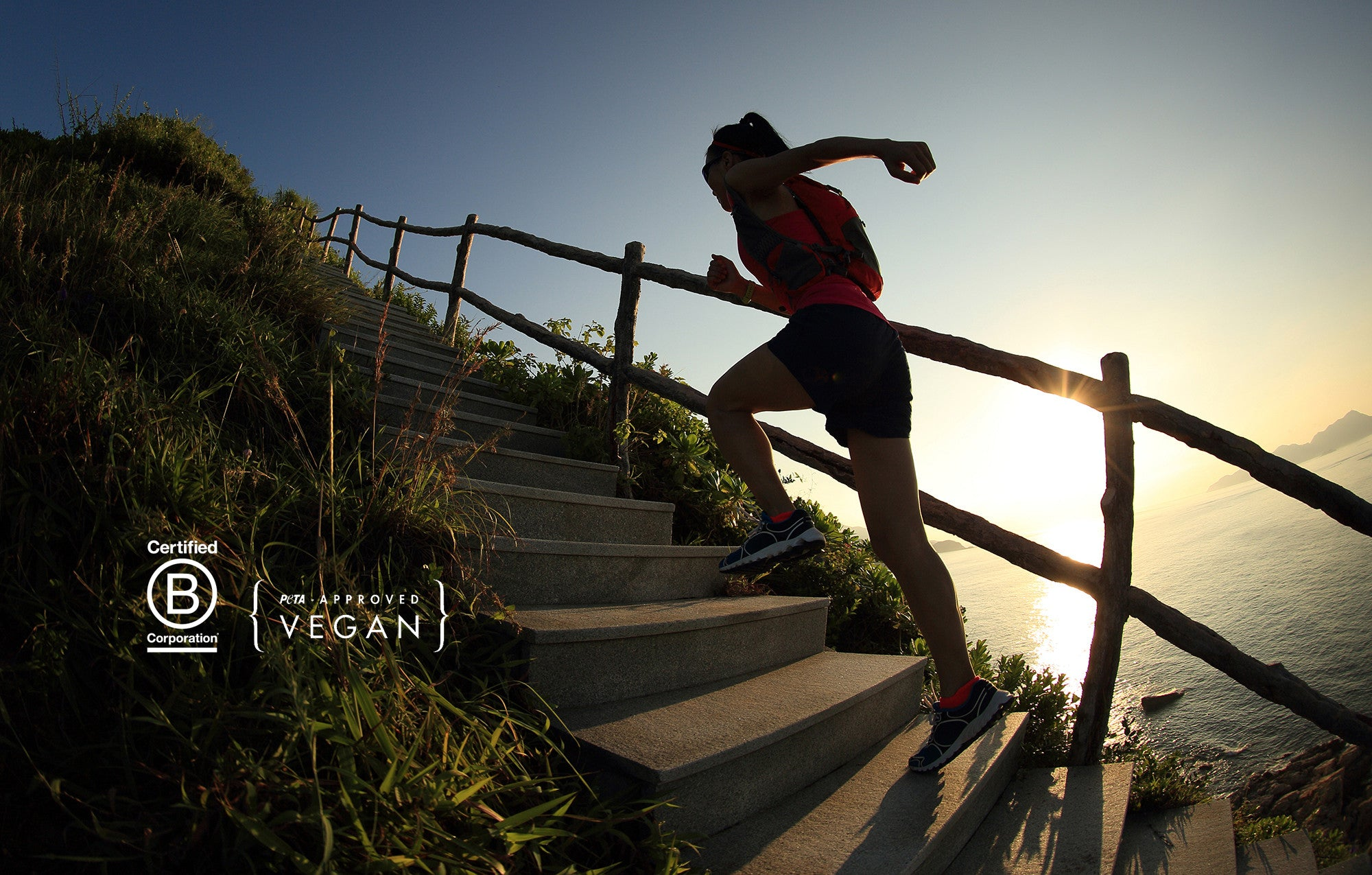 Woman running up stairs near the ocean