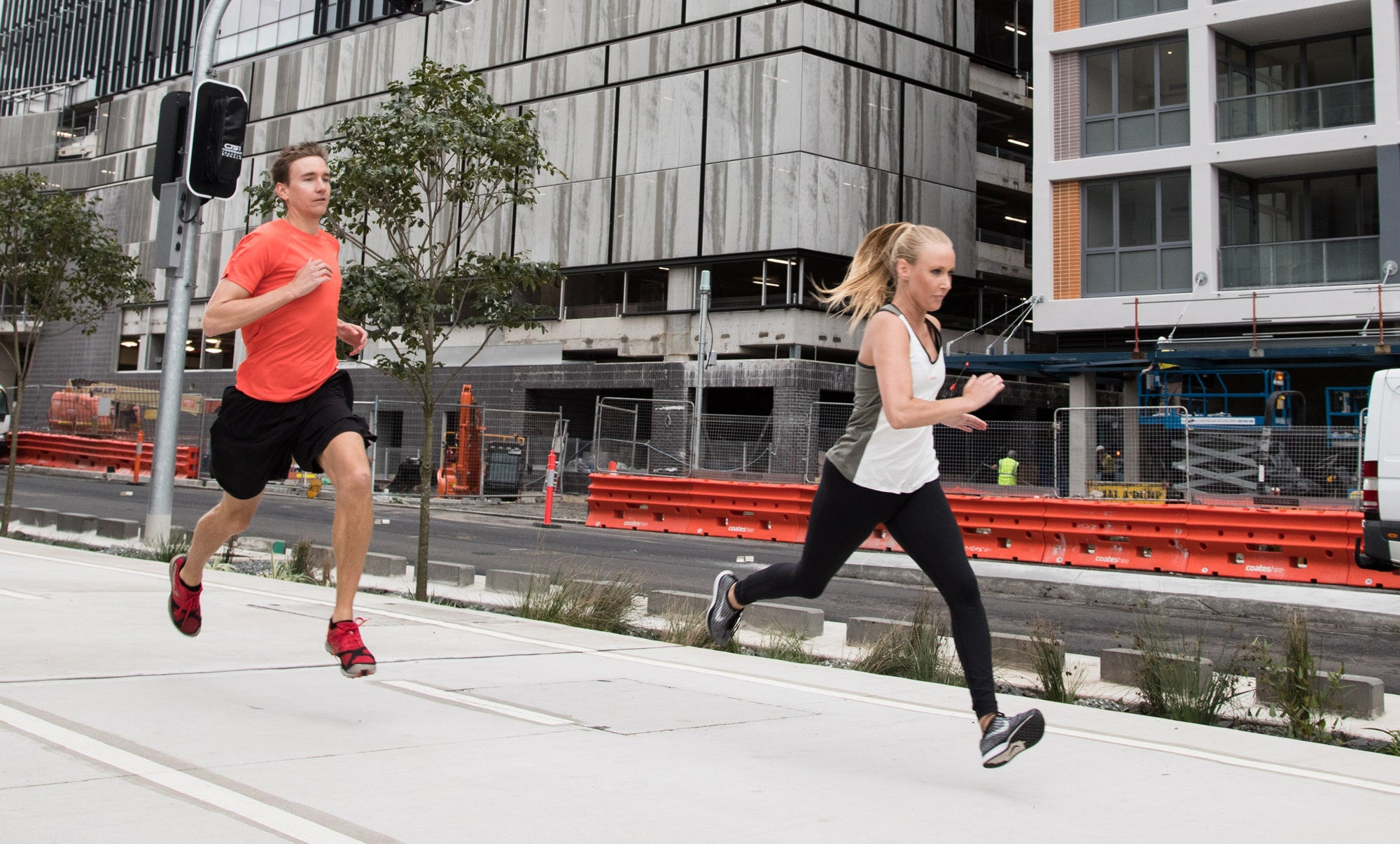 Male and female runners in the city wearing sustainable sportswear by Kusaga Athletic