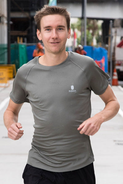 Male runner wearing a Gum leaf Grey ECODRY® Performance Run Tee from Kusaga Athletic