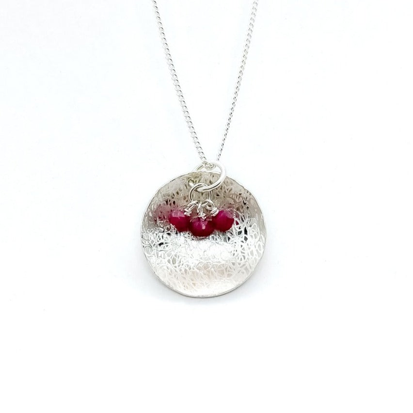 Balanced Scribbled Shell with Ruby Necklace