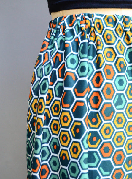 vintage 1970s geometric print maxi skirt long polygon green teal orange yellow medium small 70s seventies mod bohemian hippie fashion style concettas closet 1