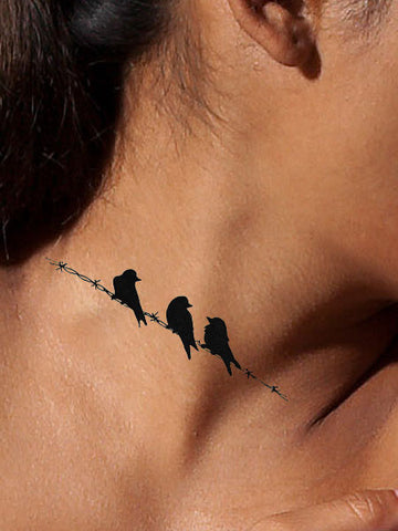 On A Wire Bird Tattoo - AsIfTattooed.com