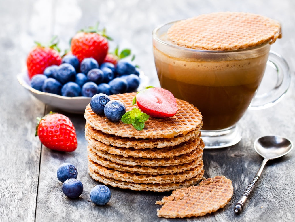 Enjoy L'Orenta Stroopwafels topped with berries for a filling treat