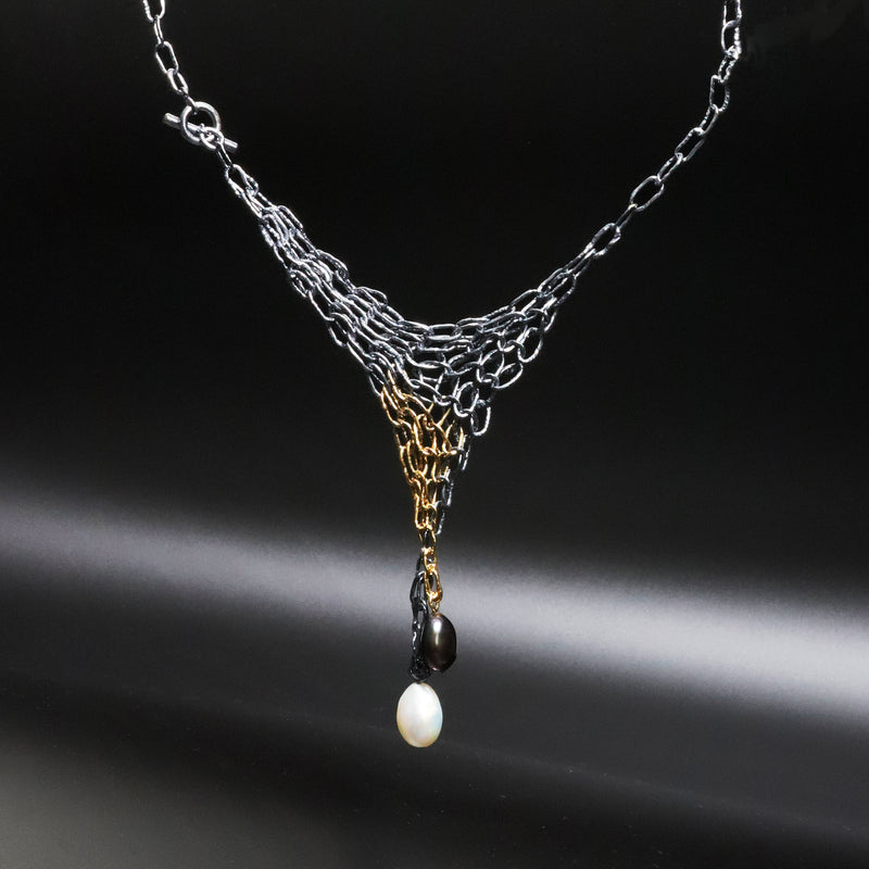 Distressed and oxidized sterling silver chainmail necklace with black and white freshwater pearls.