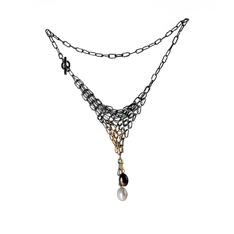 Distressed oxidized silver and 18K yellow gold chain maille necklace with a black and a white freshwater pearl.