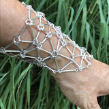 Gleaming stick links forming a sterling silver glove/bracelet