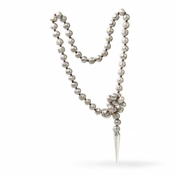 Long Y style PLUMB LINE necklace of large, light grey freshwater pearls with a sliding ring Sterling silver clasp and tapered point end. Carolina Cole.