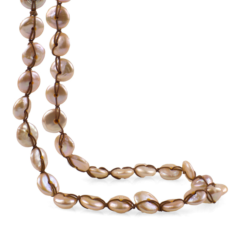 Close up of RANGE Freshwater pearl strung on thin brown leather cord with a Sterling silver clasp. Carolina Cole.