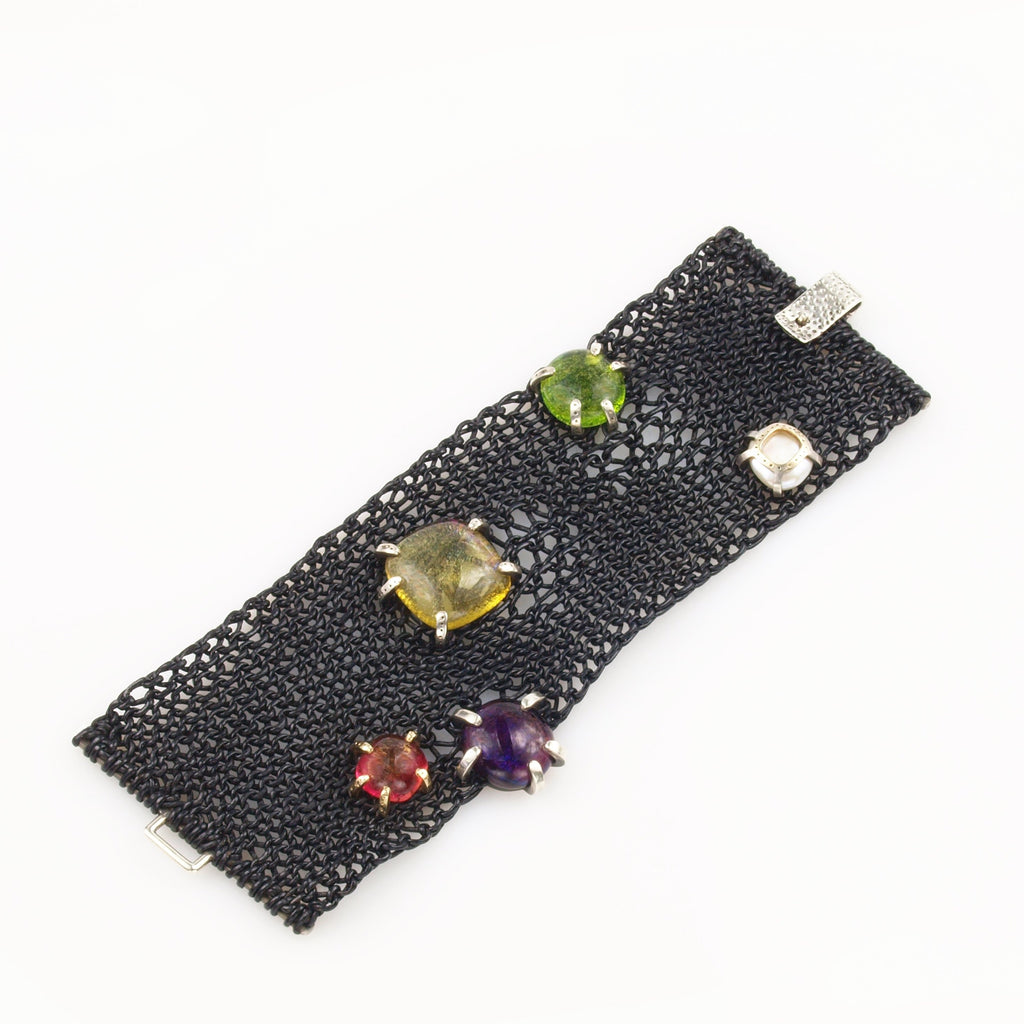 knitted black leather bracelet with glass cabochons set in Sterling silver and 14K yellow gold
