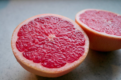 Pink grapefruit cut in half