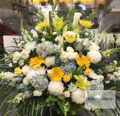 Blue and Yellow Funeral Arrangement