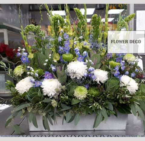 White and Blue Accent Funeral Arrangement