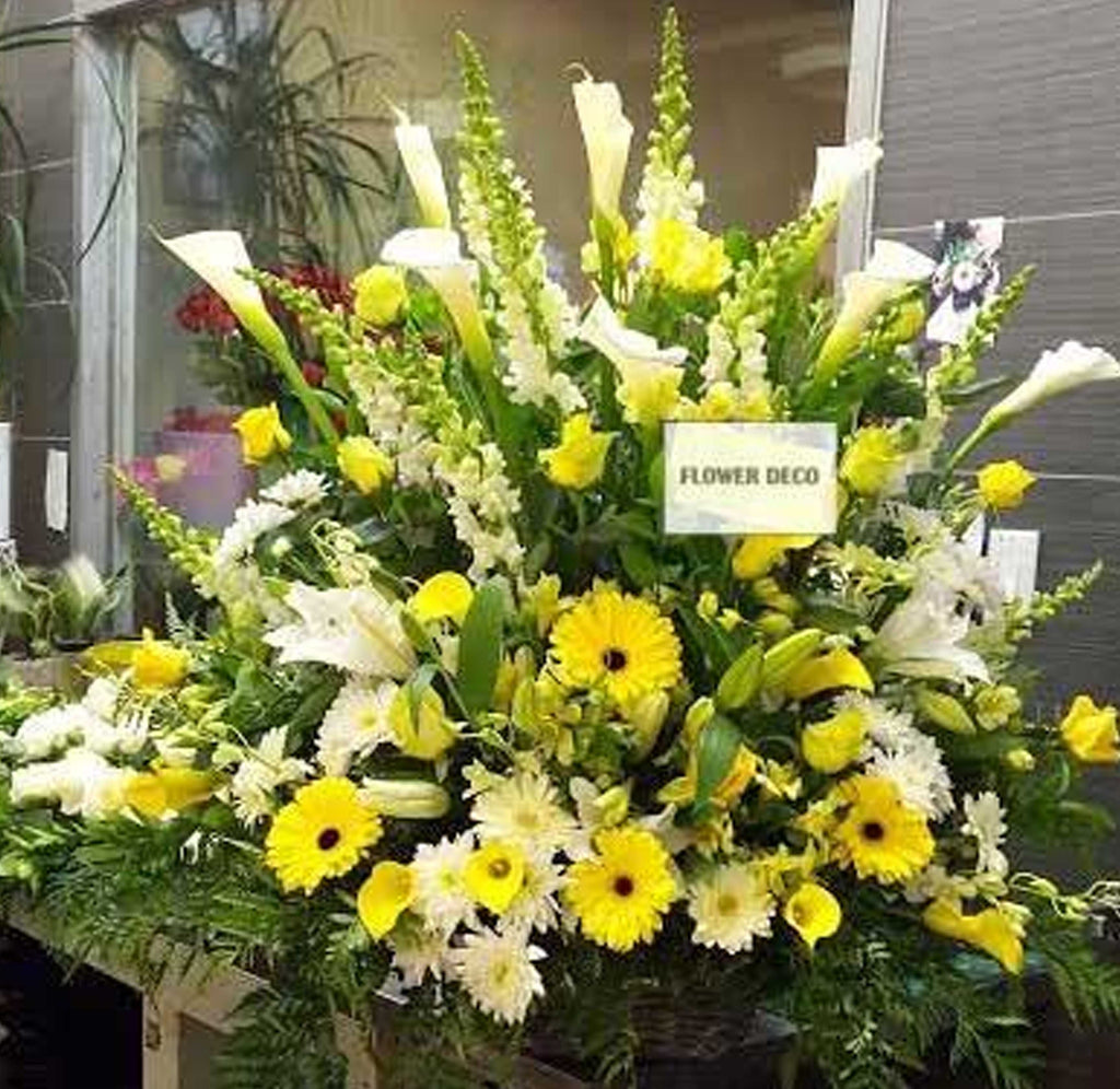 Yellow and white funeral arrangement flower deco yellow and white funeral arrangement izmirmasajfo