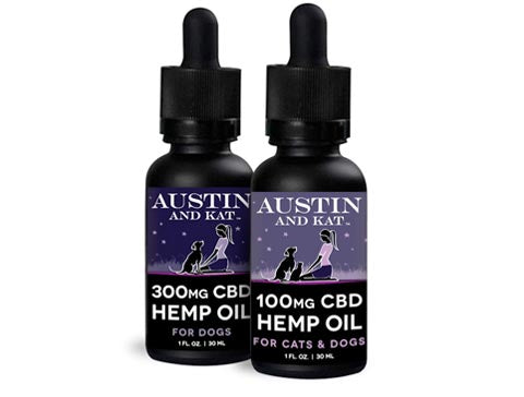 100mg and 300mg bottles stacked side by side of Austin and Kat CBD Hemp Oil for Cats and Dogs