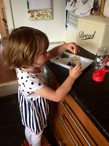Mouse making her kid friendly fruit infusing recipe