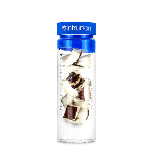 Glass fruit infusing water bottle in royal blue shown with a coconut infusion