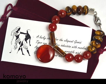 "GEMINI BRACELET <span class=""subtitle"">- Red Agate Pendant and Tiger Eye Beads </span><span class=""findings"">- Stainless Steel Findings </span><span class=""length"">- 8 Inches </span>"
