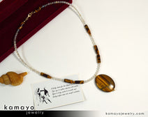 "GEMINI NECKLACE <span class=""subtitle"">- Large Tiger Eye Pendant and Botswana Agate Beads </span><span class=""findings"">- 14K Gold Filled Findings </span><span class=""length"">- 20 Inches</span>"