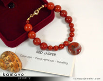 "RED JASPER BRACELET <span class=""subtitle"">- Coin Pendant </span><span class=""findings"">- 14K Gold Filled Findings </span><span class=""length"">- 8 Inches</span>"
