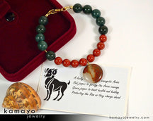 "ARIES BRACELET <span class=""subtitle"">- Coin Red Jasper Pendant and Green Jasper Beads </span><span class=""findings"">- 14K Gold Filled Findings </span><span class=""length"">- 8 Inches</span>"