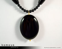 "BLACK ONYX NECKLACE <span class=""subtitle"">- Large Oval Pendant and Column Beads </span><span class=""findings"">- 14K Gold Filled Findings </span><span class=""length"">- 20 Inches</span>"