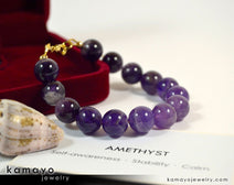 "CHEVRON AMETHYST BRACELET <span class=""subtitle"">- Large Round Natural Banded Amethyst Beads </span><span class=""findings"">- 14K Gold Filled Findings </span><span class=""length"">- 8 Inches</span>"