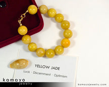 "YELLOW JADE BRACELET <span class=""subtitle"">- Big Round Beads </span><span class=""findings"">- 14K Gold Filled Findings </span><span class=""length"">- 9 Inches</span>"