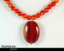 "RED AGATE NECKLACE <span class=""subtitle"">- Natural Oval Pendant and Round Beads </span><span class=""findings"">- Stainless Steel Findings </span><span class=""length"">- 18 Inches </span>"