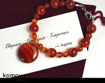 "RED AGATE BRACELET <span class=""subtitle"">- Dark Beads with Translucent Bands </span><span class=""findings"">- Stainless Steel Findings </span><span class=""length"">- 8 Inches </span>"